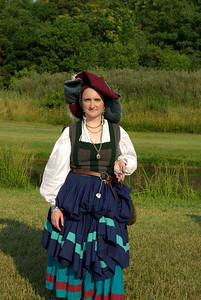 Here I am showing the cast metal stag's head award I received for having the spiffiest costume. I didn't exactly dress for the heat. This is early 16th century German. The outer sleeves are tied on but tucked into the back of my belt since it was so hot out. Thanks, Mieszko, for taking this pic. (Mieszko won the award with me.)